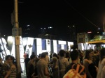 White Night sign surrounded by people in Melbourne