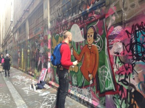 Artist at work in the lanes by Melbourne - photo by NotaHati