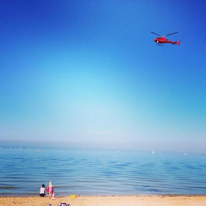 Helicopter, sun, sea, sand and sun seekers on a Sunday morning - photo by NotaHati
